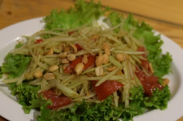Raw papaya salad with nuts