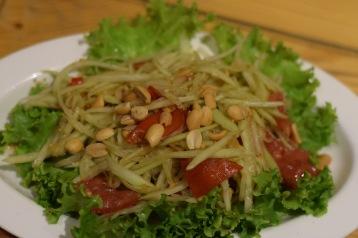 Raw papaya salad with nuts